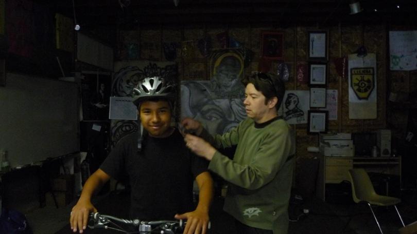 Mark putting helmet on antonio