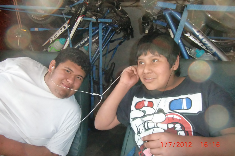 boys sharing some music