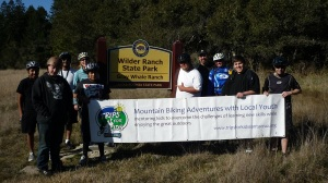 participants & volunteers at the sign