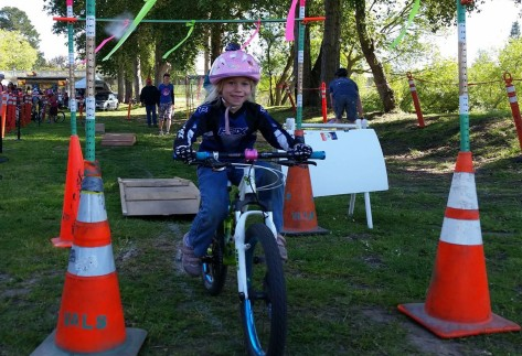 Girl rides the ramps at the Santa Cruz Mountain Bike Festival Bike Rodeo April 2015