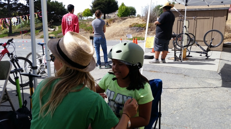 Kira from Bike Smart fits a kid with a helmet